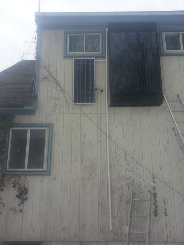 Solar Can Heater on House